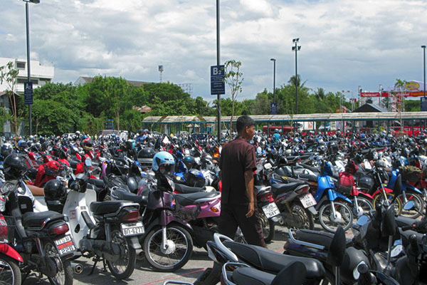 The parking lots at the shopping mall are as big, if not bigger than in the US. They separate motorbikes from automobiles, and ours was near B2.