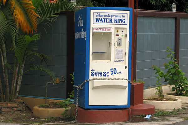 In Thailand, tap water is not drinkable.  Therefore, domestic drinking water has to be purchased from another source.  In most neighborhoods in Chiang Mai, we have found these Water King vending machines that charge 1baht/2liters.  We venture down every couple of days with 2 1baht coins and a 5 liter jug obtain our drinking water!