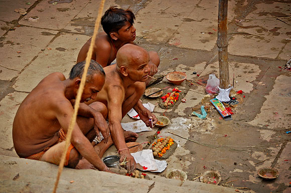 Men preparing to bathe in the Ganges River at Assi Ghat