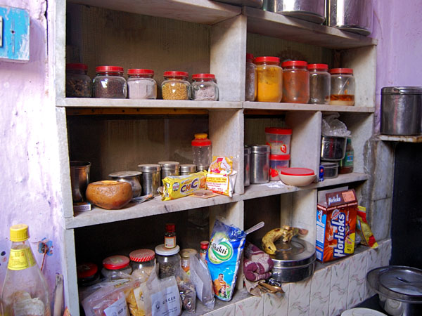 The kitchen is stocked with various spices, grains and the occasional sweet for the girls