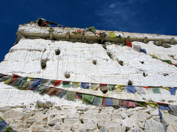 Prayer flags drape across the Buddhist Stupa to the south of town.