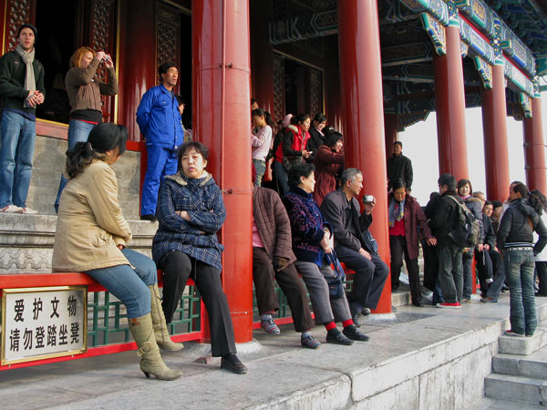 Visitors congregate on the south side of the hill overlooking the Forbidden Palace