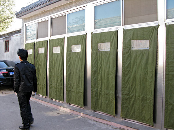 It seems like there are public restrooms around every corner of the hutongs.  here, stalls are shielded from the cold with army weight blankets.