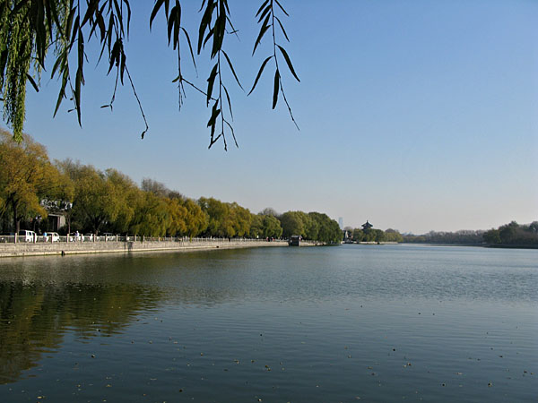 A quiet lake in the middle of the city surrounded with cafes, shops, benches and paddle boats