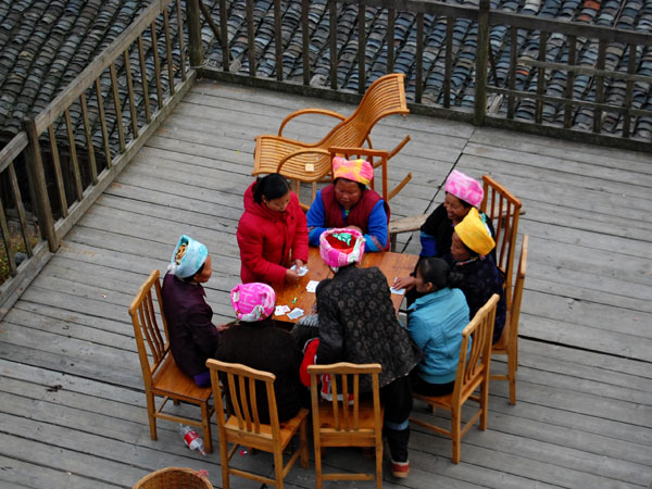 Local ladies play cards on the porch