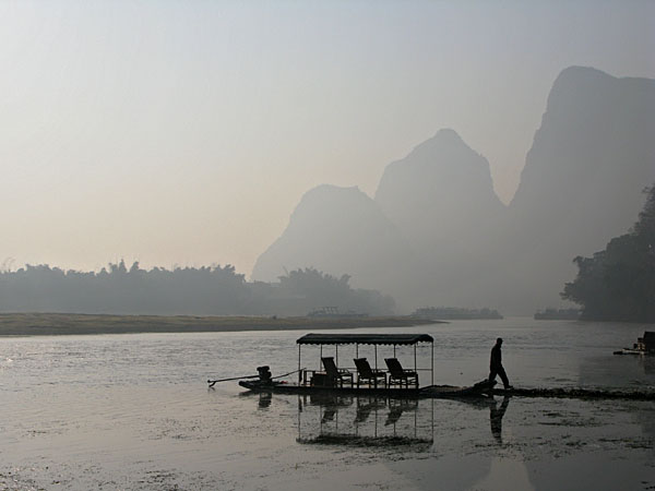 A bamboo raft on the Li River at dusk
