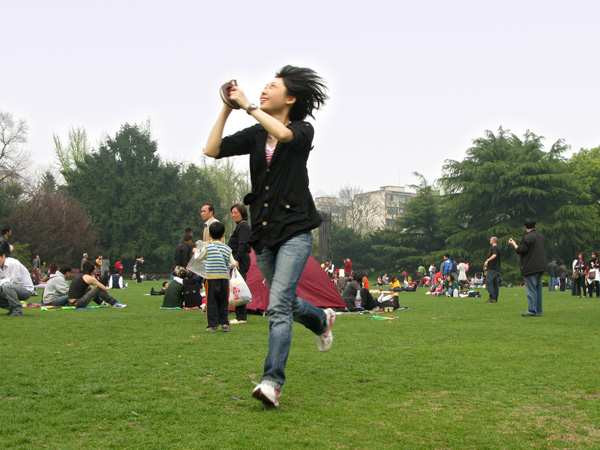 She flies her kite.
