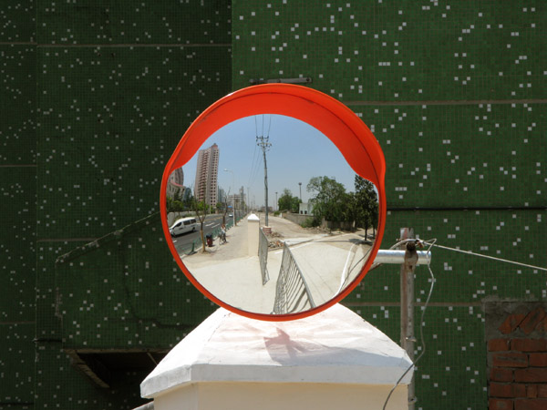 One of many mirrors to help construction traffic move safely.