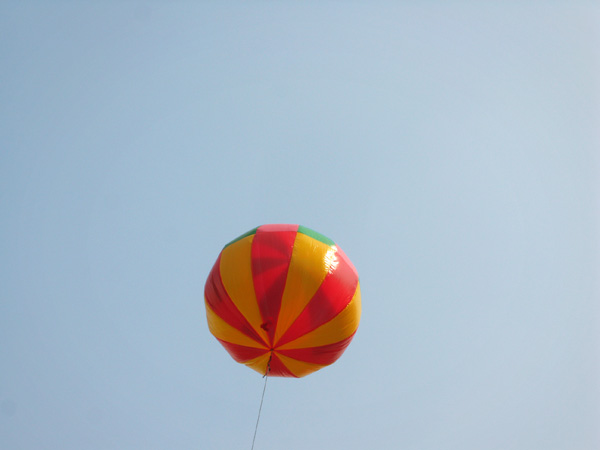 A huge balloon floats above the crowds at today's Dragon Boat Festival