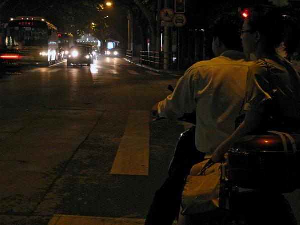 Lady sitting side-saddle at a stop light