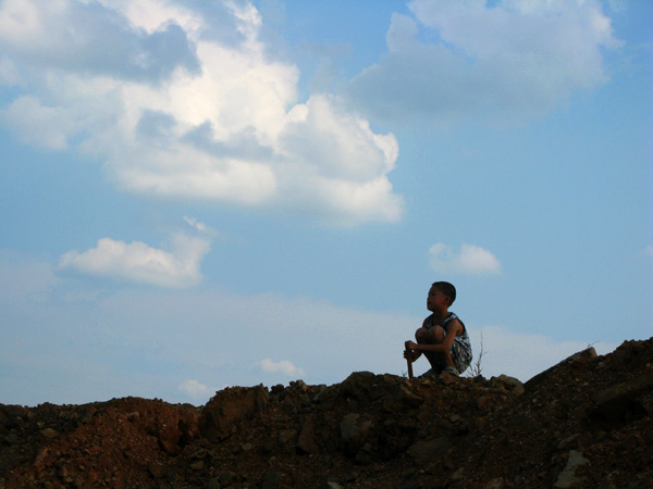 Little Boy in Thought