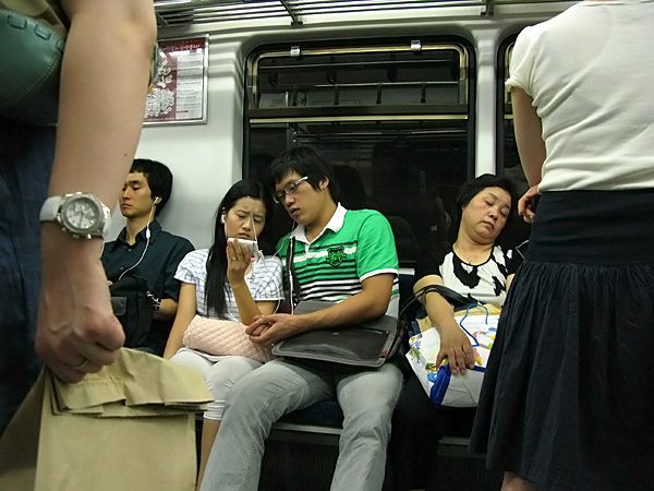Couple #4....watching broadcast TV on the subway??