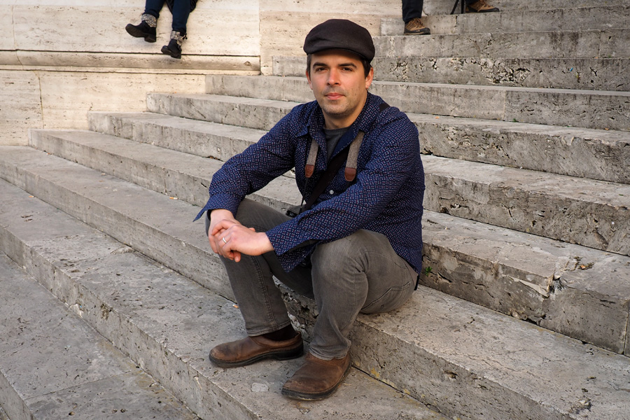 Nik on the steps in front of the Supreme Court building